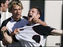 James Grady (right) celebrates his winning goal