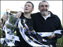 Gretna striker James Grady and owner Brooks Mileson celebrate