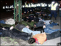 Estonian police ring prone detainees after the riots