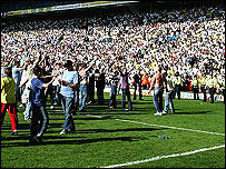 Fans encroach onto the pitch during Leeds' draw with Ipswich