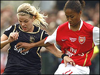 Lisa Dahlqvist of Umea IK tries to tackle Arsenal's Rachel Yankey