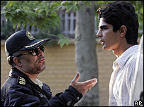 Policeman talks to a man in Iran
