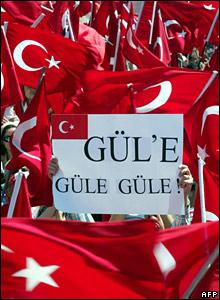 "Sign held up saying ""Goodbye Gul"""