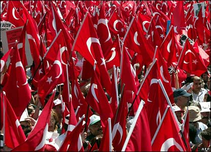 Many Turkish flags held up