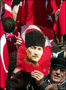 Man holds up portrait of Ataturk