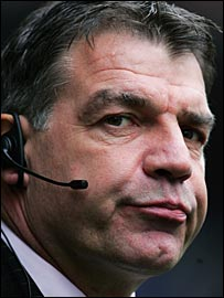 Sam Allardyce uses an earpiece to communicate with his coaching staff on the bench