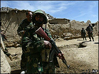 Afghan national army soldiers stand guard during a search operation near Daychopan village in Zabul province, south-eastern Afghanistan.
