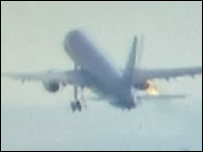 Flames coming from engine after plane hit by birds (picture sent by BBC viewer)