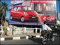 Suzuki Zen advert, with man on foot and man on motorcycle passing