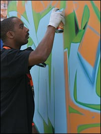 Graffiti artist SUCH adds the finishing touches to the Your Game graffiti wall