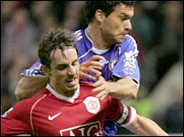 Man Utd's Gary Neville (left) competes with Chelsea's Michael Ballack for the ball