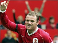 Wayne Rooney celebrates scoring against Fulham on the opening day of the season