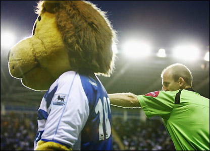 Mike Riley orders Kingsley the Lion away from the pitch