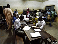 Scrutineers take part in the official count of the ballots in Mali