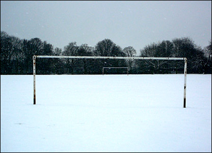 Snow covered football pitch