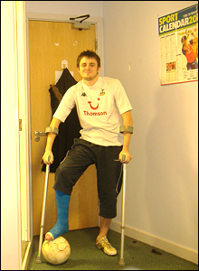 Rob Press on crutches gets ready to play football