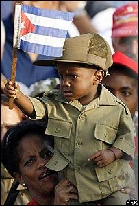Cuban boy waves flag at parade