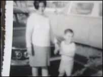 A black and white photograph of Manuel Uribe and his mother
