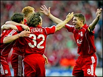 Gerrard (right) leads the celebrations after Daniel Agger's opener