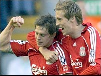 Daniel Agger (left) celebrates scoring with Peter Crouch
