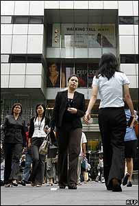 Office workers walk during their lunch break in Singapore