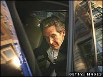 Lord Browne getting into a car