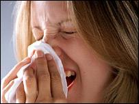 Lady sneezes