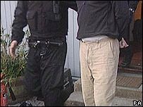 A man being arrested in the raids