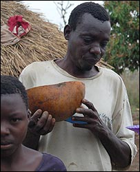 Moses Odia holds a calabash to represent his late mother, Beca