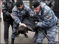 Russian riot police arrest a pro-Kremlin youth group member at a rally in front of Estonian embassy in Moscow (1 May)