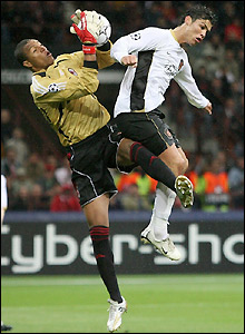 Dida claims the ball under pressure from Ronaldo