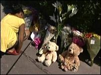 Girl laying tributes to Kamilah
