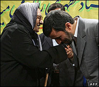 President Ahmadinejad kisses his teacher's hand