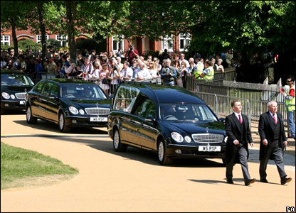Funeral cars and onlookers