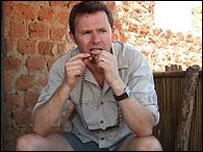 Stefan eating food in Uganda
