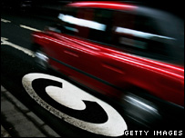 Car driving over a congestion charge road marking (Getty Images)