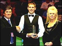 Daniel Wells receives the award