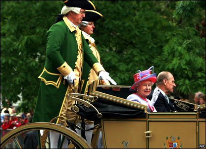 The Queen and Prince Philip in a horse-drawn carriage in Colonial Williamsburg