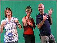 Three people signing