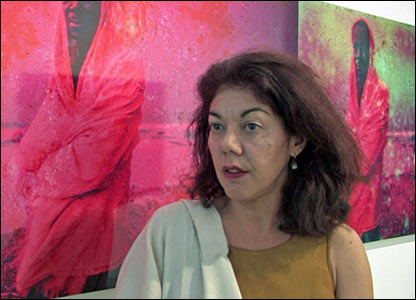 Algerian artist Sophie El Baz in front of her photographs
