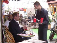 French waiter and restaurant diner