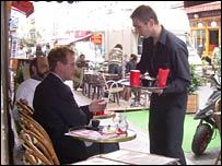 French waiter and restaurant diner