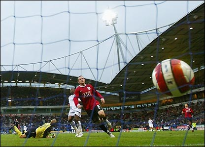 Wayne Rooney completes his hat-trick at Bolton