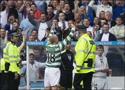 : Celtic captain Neil Lennon gets a warm reception from the Rangers fans at half time