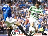 Brahim Hemdani and Celtic's Paul Hartley