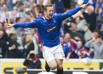 Rangers v Celtic: Adam races to the Rangers bench after scoring
