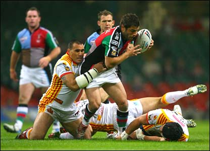 Chad Randall is held by the Catalans defence