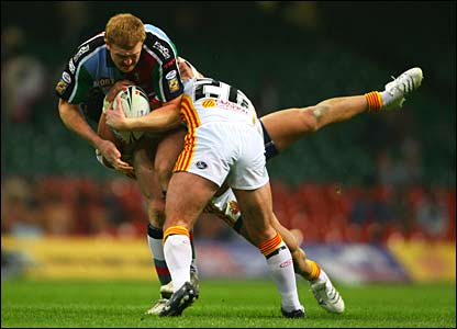 Jon Grayson of Harlequins is tackled