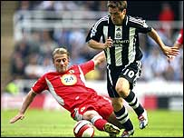 Blackburn's Tugay (left) tackles Newcastle's Michael Owen