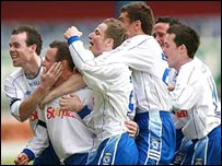 Rory Hamill celebrates with team-mates after scoring in the final